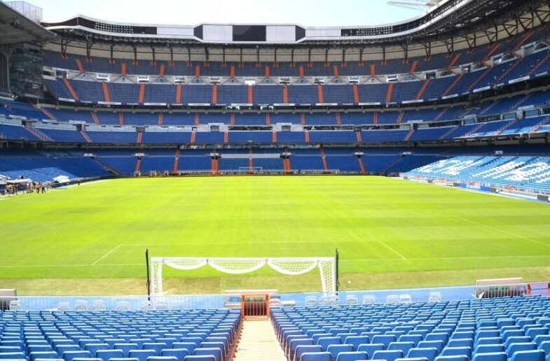 Go to a football match in Madrid